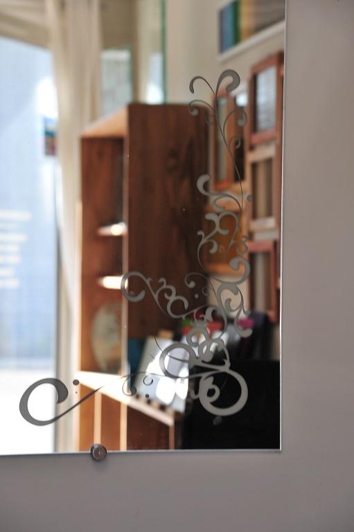 Gravure sur miroir de style arabesque